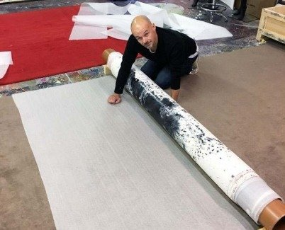 Rolling a canvas round a tube