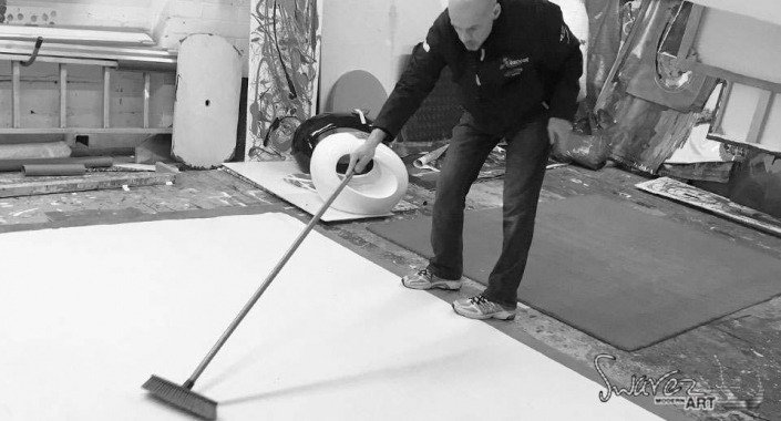 Sweeping the back of a canvas painting