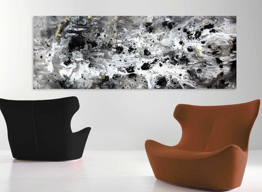 Two chairs and a black and white painting