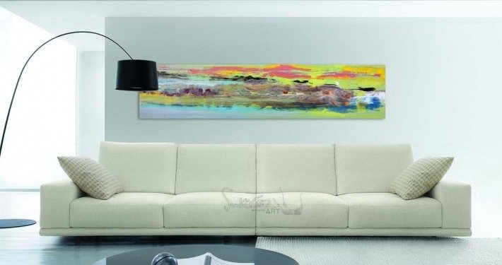 Multi-coloured bright art above a beige sofa