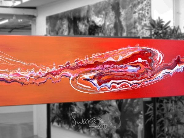 Red abstract painting in an art gallery