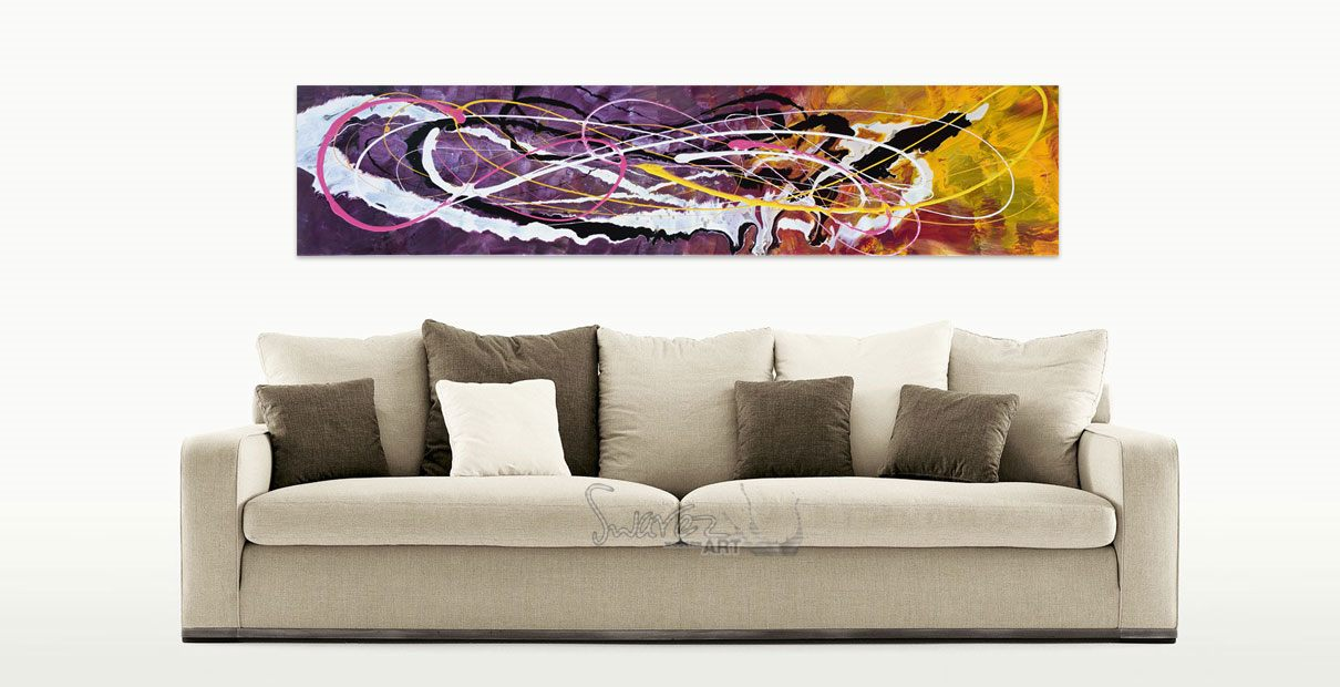 purple and yellow art above a taupe sofa
