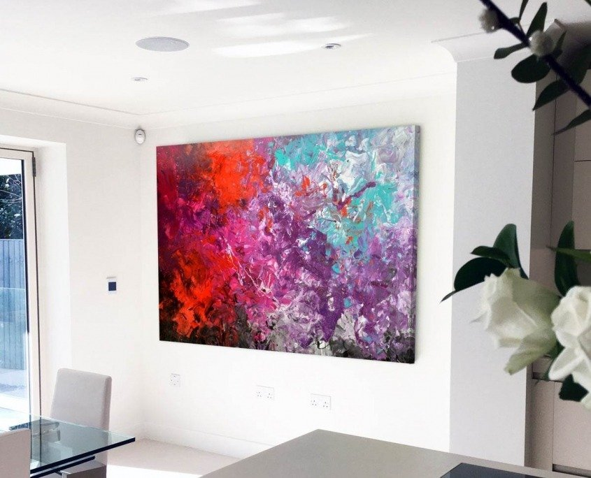 red purple turquoise abstract art in kitchen