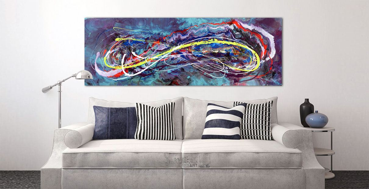 Colorful contemporary painting above a white sofa