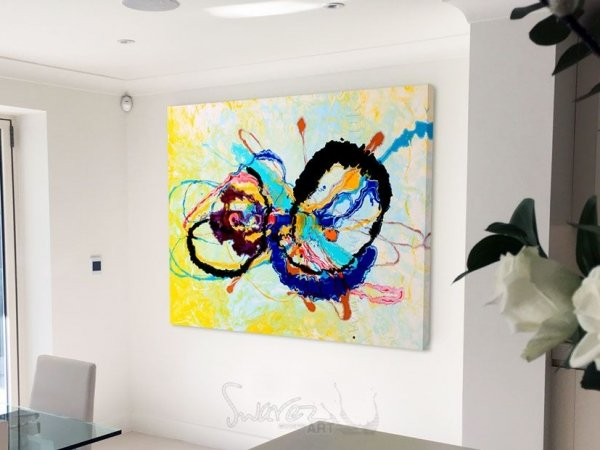 Colourful abstract art in a dining room