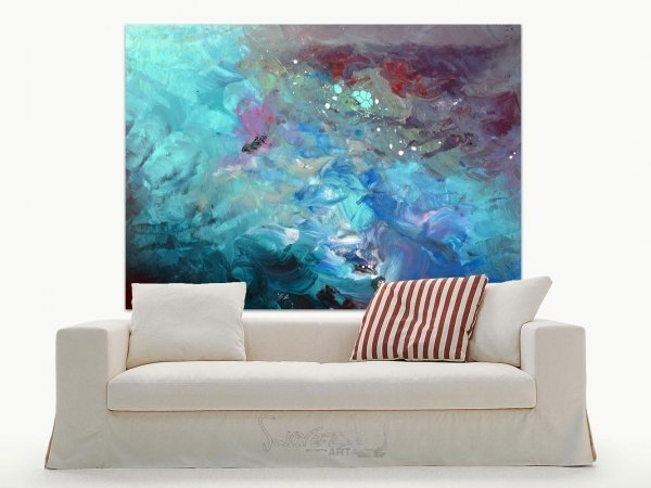 Large abstract art above a cream sofa