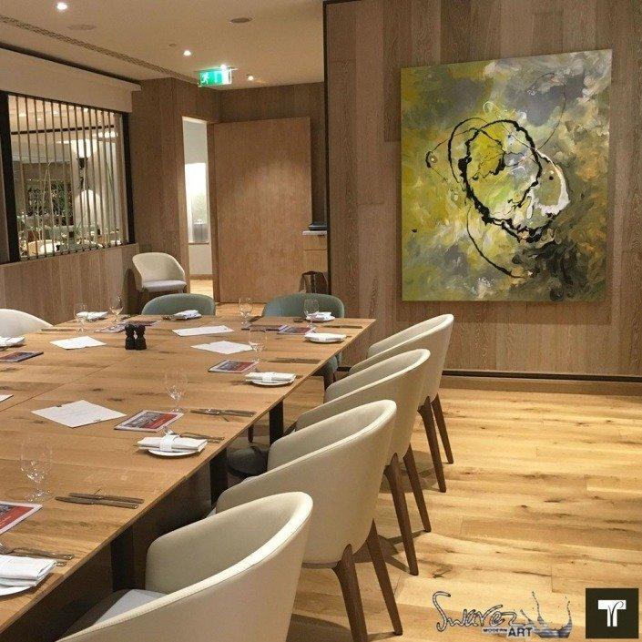 Mustard and black art in Theo Randall's restaurant