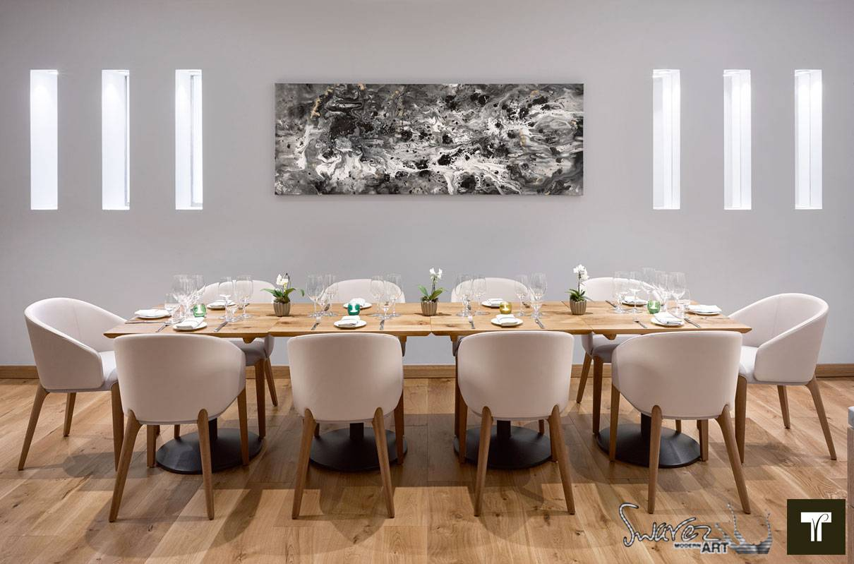 Meteopric Rise Painting Hanging Above A Long Dining Table And Chairs