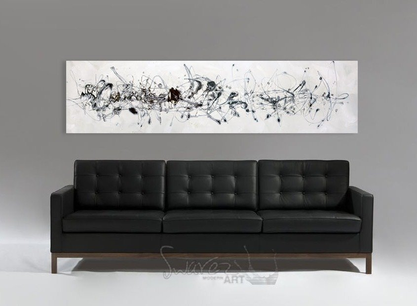 Black sofa with cream and white art
