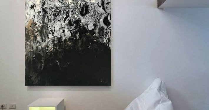 Black and silver art hanging vertically