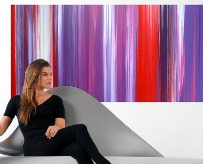 purple abstract art and a woman on a chair