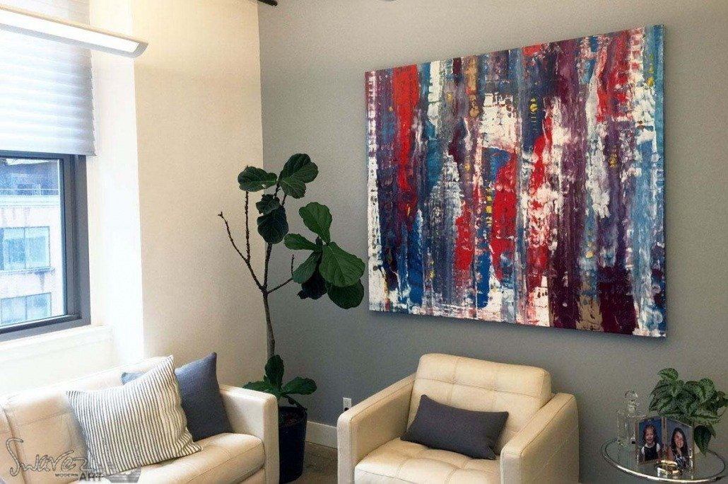 Large original art called Living On The Edge hanging in a reception area
