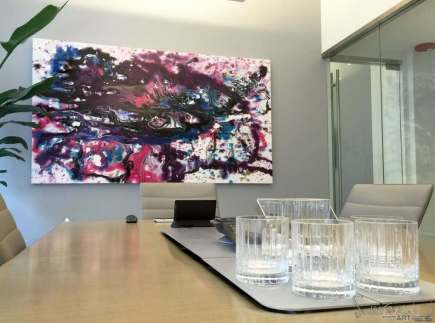 Purple and pink art in a boardroom