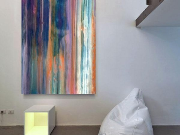 Vertically hung abstract paintng