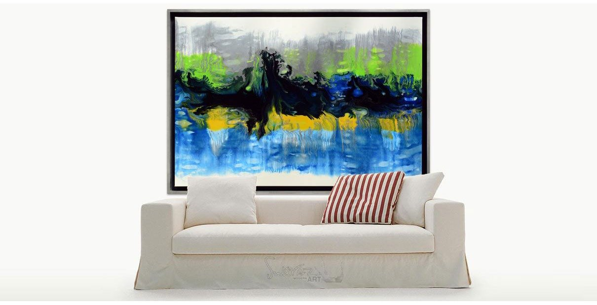 Sofa with striped cushion and green and blue art above it