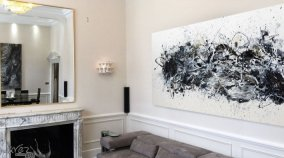Large black and white modern art in a living space