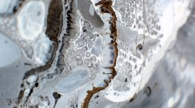 Droplets of silver and white paint