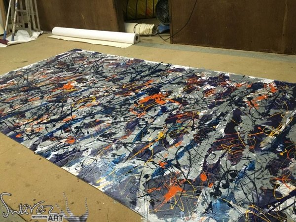 Working on a large drip painting