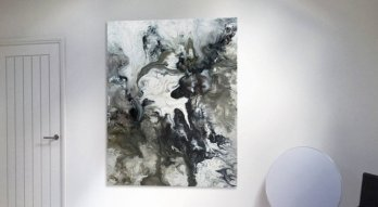 Fluid smokey grey and black painting on a wall