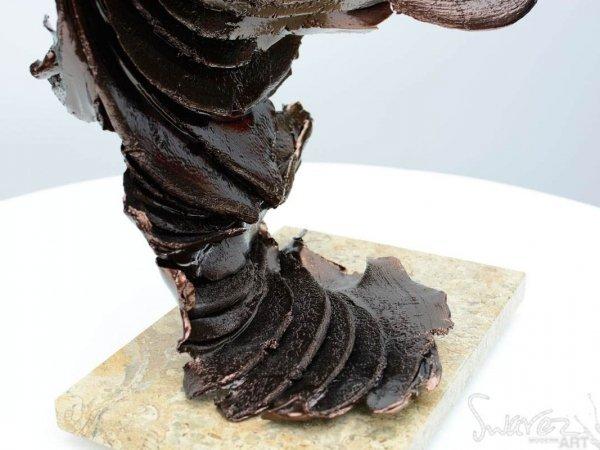 Bronze coloured tall sculpture