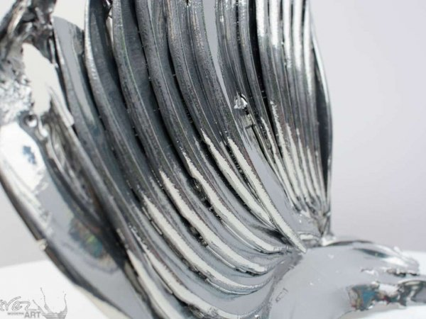 Side view of a chrome plated sculpture called Vulcan