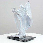 White metal scuplture like a wing