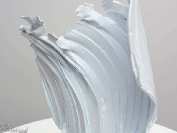 Close up of a white coloured metal sculpture