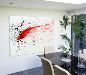 red-black-and-white-abstract-painting-hanging-in-a-room-2