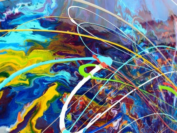 rainbow loops of paint in multiple colours on canvas