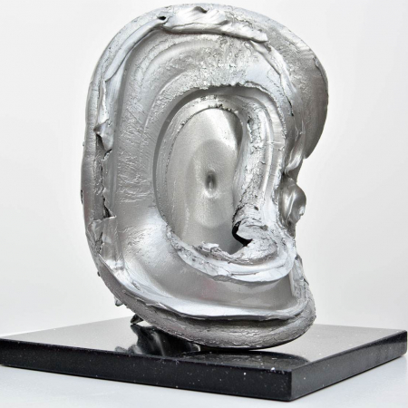 Silver sculpture on a black granite base