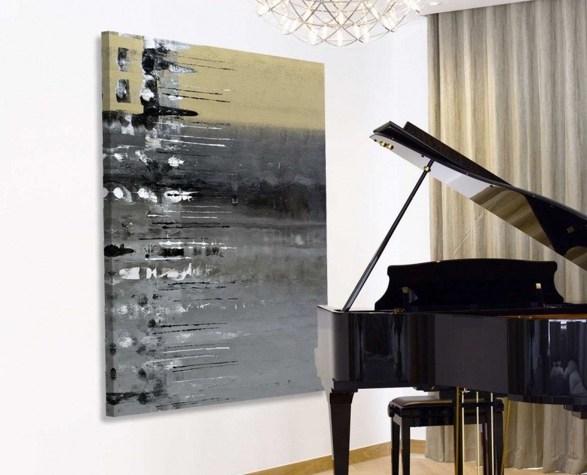 Gold and silver painting behind a baby grand piano