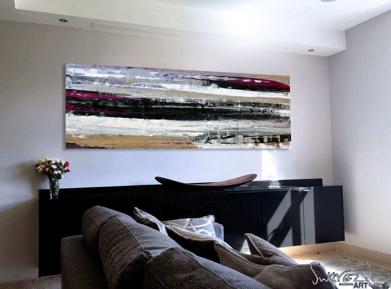 Black and gold-abstract-art-in-a-living-room