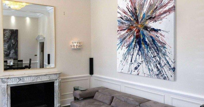 Grey sofa with large art