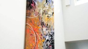 Tall contemporary painting in a large open plan entrance