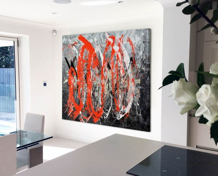 Large red and black art in a kitchen