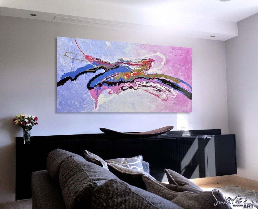 Pink and blue art on a wall