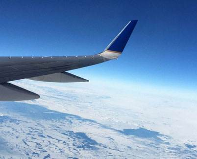 Plane wing and blue sky