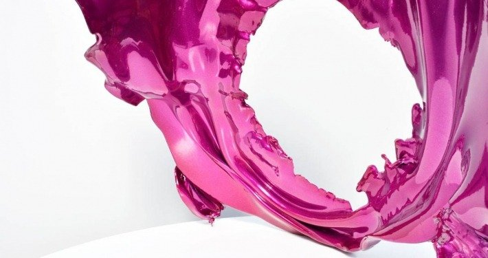 Pink metal sculpture on white table