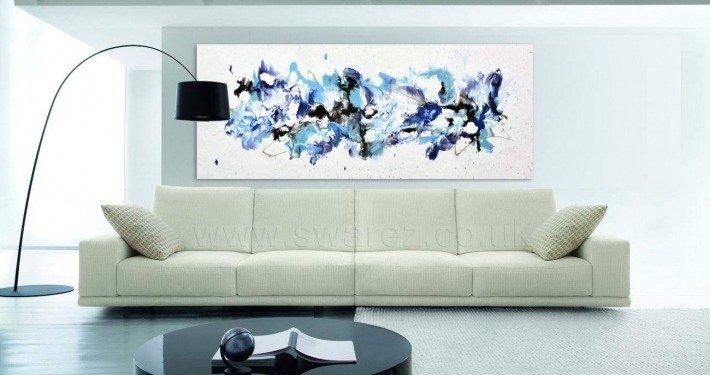 original large painting and cream sofa