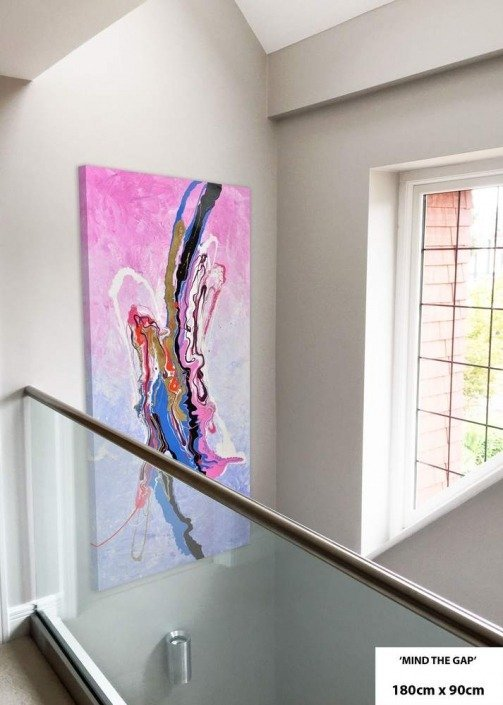 pink and blue art in entrance hall