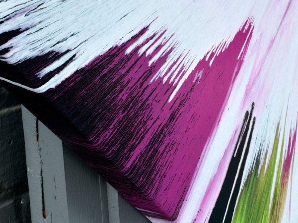 Purple paint on the edge of canvas