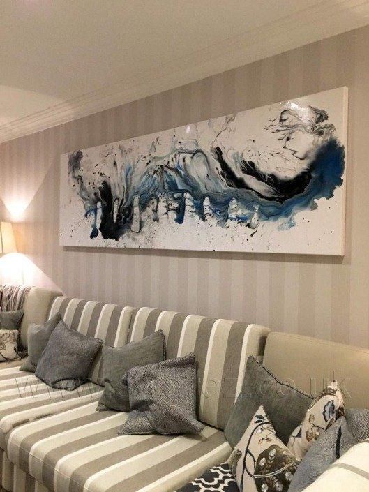Blue art and striped sofa