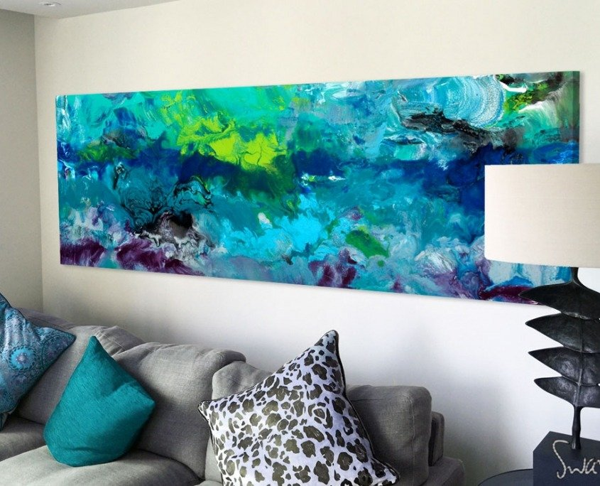 Blue green painting above a sofa