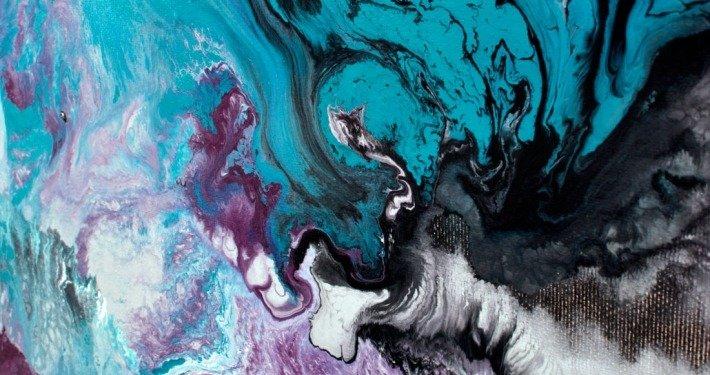 Purple and black swirls of paint