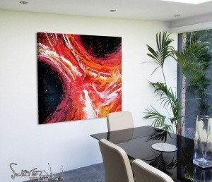 Red orange and black art in dining room