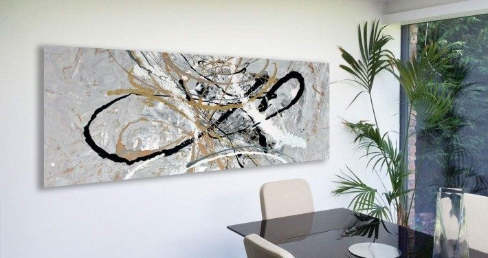 Silver and gold art in dining room
