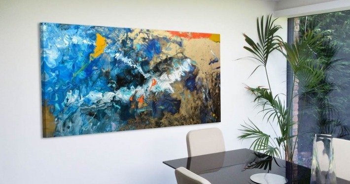 blue and gold abstract art in dining room