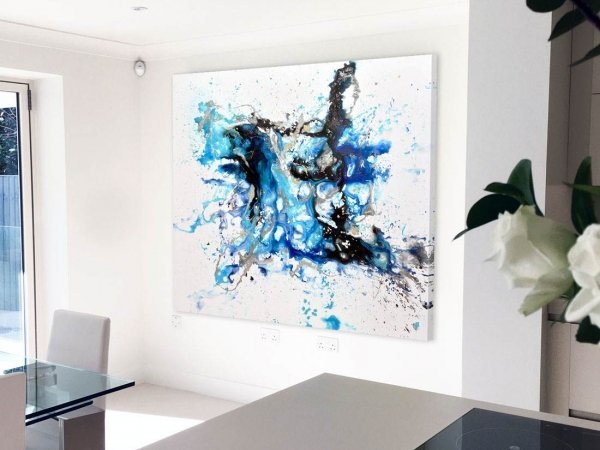 blue black and gold art in a kitchen