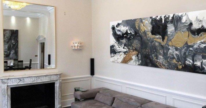 Terraformer painting and grey sofa