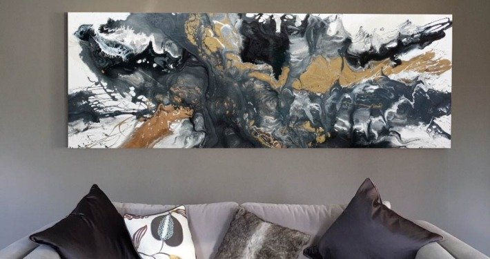 white sofa grey art